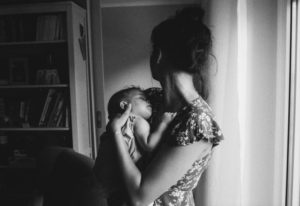 Breastfeeding mother with her child